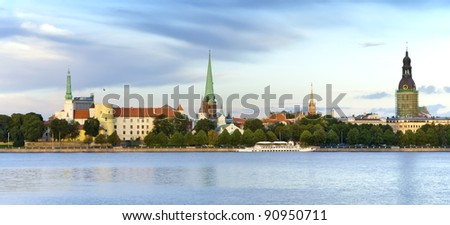 View on the old city of Riga from embankment of the Daugava river, Latvia, Europe - stock photo