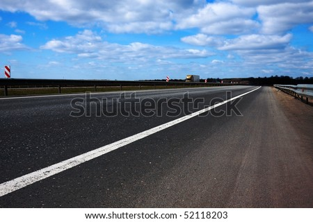 View on the road - good for transport and travel. Cloudy skyline - stock photo