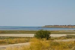 View on the Sivash lake in Ukrainehttps://cdn.shutterstock.com/shutterstock/pending_photos/977033848/thumb.jpg