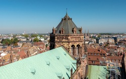 View on the Strasbourg Cathedral (French: Cathédrale Notre-Dame de Strasbourg), also known as Strasbourg Minster, a Catholic cathedral in Strasbourg, Alsace, France. Blue sky and sunny day.