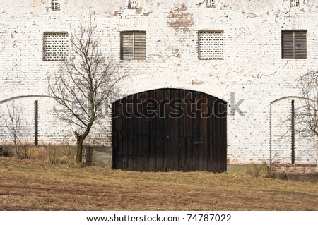 View on the white barn with wooden door