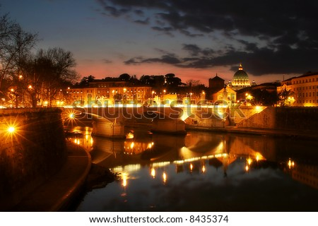 View on Tiber river and night illuminated Vatican city at evening from Saint Angel Bridge in Rome, Italy. - stock photo