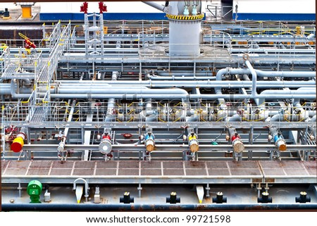 View on top of a vessel ship deck with industrial storage