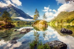 View on turquoise water and scene of trees on a rock island at Lake Hintersee. Location famous resort National park Berchtesgadener Land, Ramsau, Bavaria, Alps. Europe. Artistic picture. Beauty world.
