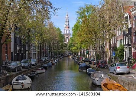View on Zuiderkerk (South church) from Groenburgwal canal in Amsterdam, Netherlands