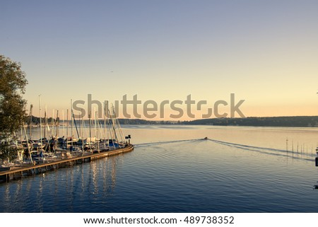 View onto Lake Wannsee in Berlin Germany with a Harbor in the Very Morning  #489738352