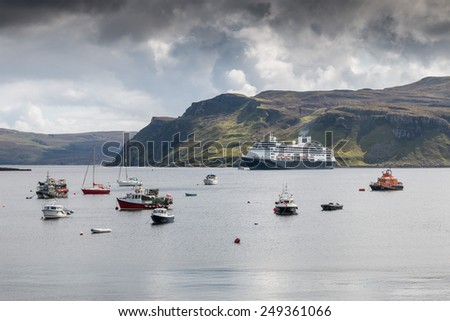 View onto Portree harbor, with ships and boats and some colorful houses, Isle of Skye, Scotland #249361066