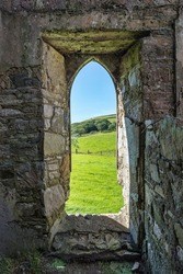 View out of an old castle window looking out onto the Irish countryside