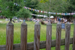 View over a fence into a garden, the wooden fence is the eye catcher