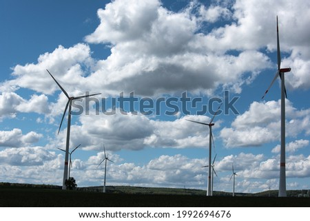 view over a rural landscape in swabian alb with rotating wind turbines Imagine de stoc ©