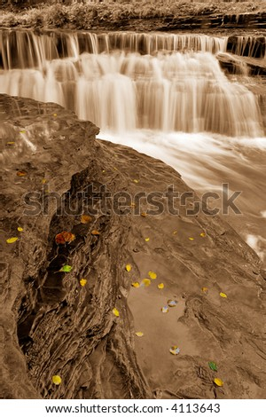 View, over cliff with autumn leaves, to Waterfalls