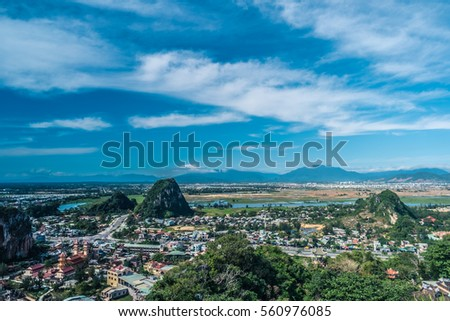 View over Da Nang Cityscape and the Other Elemental Marble Mountains from the Top of Thuy (Water) Mountain, with More in the Haze on the Horizon of Vietnam #560976085