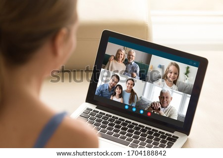 View over girl shoulder, use webcam and laptop enjoy distant communication with family. Diverse relatives people chatting via videoconference application modern technology for make life easier concept