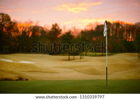 View over golf course at sunset.