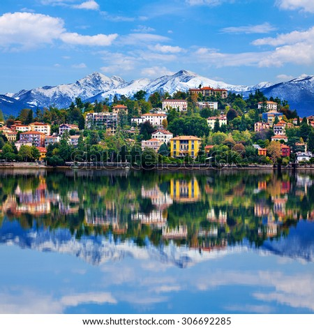 View over Lake Maggiore and Alps mountains with Verbania town in Northern Italy. #306692285
