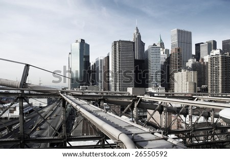 View over Manhattan, New York with Brooklyn bridge sections, rough industrial toning