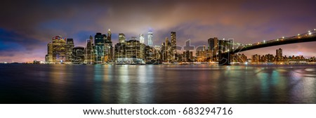 Stock Photo View over Manhattan skyline during sunset.