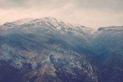 View over misty mountain rock in the Moraca river canyon in north Montenegro, Balkan peninsula, in winter