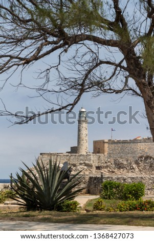 View over Morro Castle, fortress (Castillo De Los Tres Reyes Del Morro) and a lighthouse in Havana, Cuba. Blue water and blue clear sky.