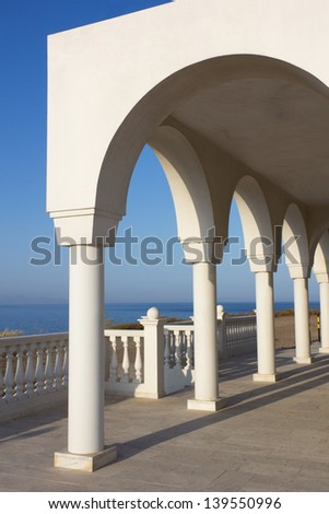 View over the Aegean Sea from the porch with arches and columns of orthodox church Profitis Ilias in Keratea, near Lavrio, in East Attika, Greece.