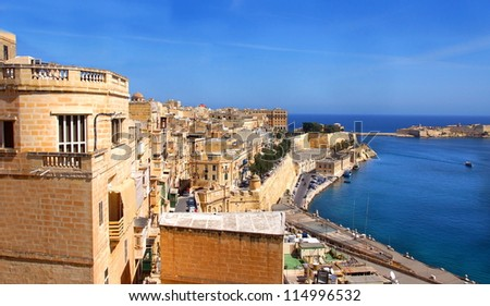 view over the city of Valetta with the ocean and the entrance to the grand harbour on the background