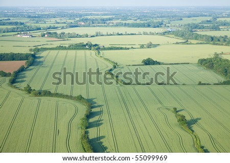 view over the early summer green fields from hot air balloon; East Anglia; UK; - stock photo