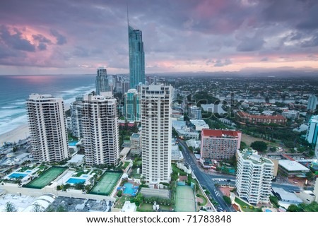 view over the modern city at twilight with ocean beside (gold coast,qld,australia)