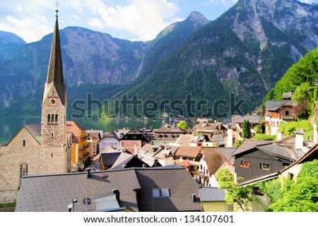 View over the quaint town of Hallstatt with Alps in background, Austria