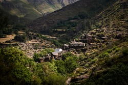 View over the small and abandoned schist village of Drave in Portugal, in the middle of mountains and valleys