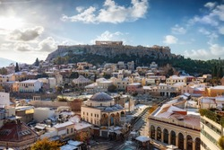View over the snow covered old town Plaka of Athens, Greece, to the Parthenon Temple of the Acropolis on a cold winter day