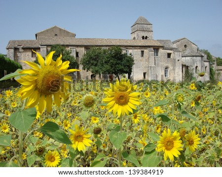 View over the sunflower fields to the Saint-Paul Asylum, Saint-R�©my - Van Gogh painted many of his beautiful creations here