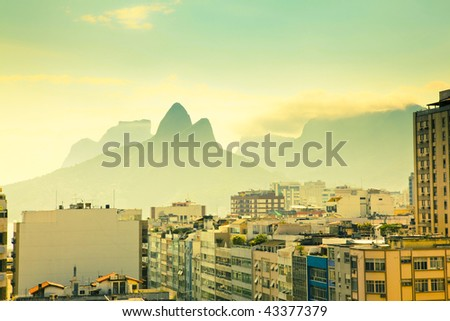 view over tops of residential buildings and mountains in Ipanema Rio de Janeiro Brazil