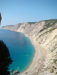 View over white crescent of Ammos beach in Kefalonia, Greece. Vertical