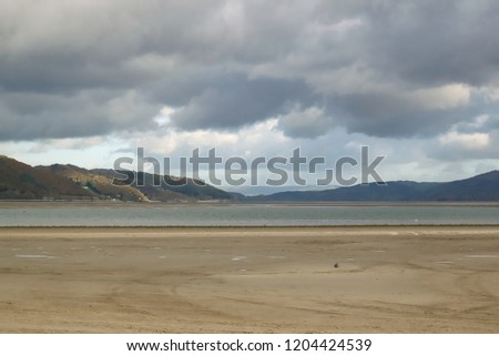View over Ynyslas beach estuary towards Snowdonia. Dyfi estuary, Ceredigion North Wales