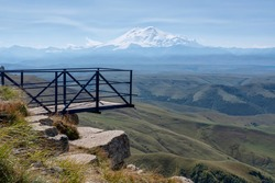 View point on Bermamyt plateau and mount Elbrus on sunny day. Karachay-Cherkessia, Caucasus, Russia.