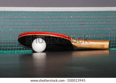 view table tennis racket with a large ball and net