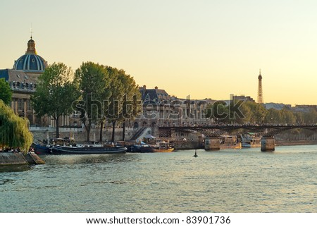 View the banks of the Seine and the Eiffel Tower in Paris on a summer evening