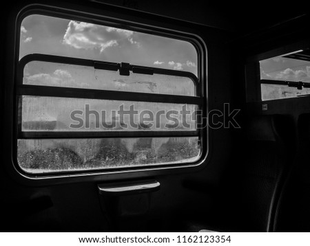 view through a window's train in black and white conceptual  #1162123354