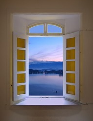 View through an old-fashioned window of the early morning dawn at the beautiful Sun Moon Lake in Taiwan