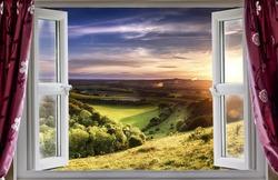 View through an open window onto beautiful landscape