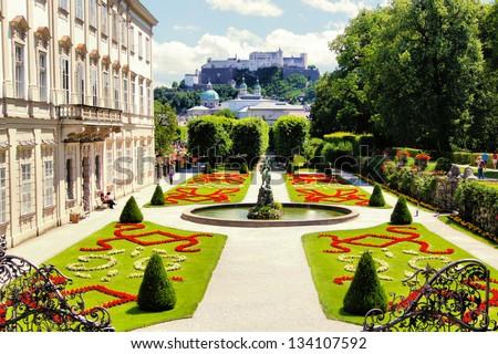 View through beautiful gardens to historic castle, Salzburg Austria