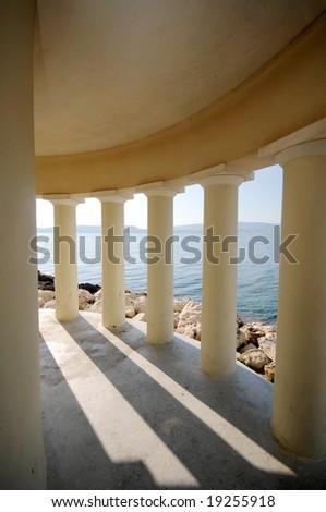 View through columns of the lighthouse in Argostoli, Kefalonia, Greece