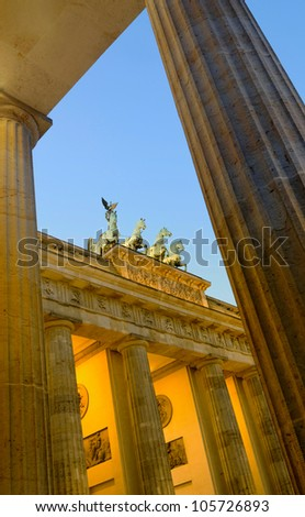 View through the columns at the side up to the Quadriga and the Brandenburger Tor, Berlin, Germany.