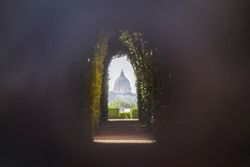 View through the knights of malta keyhole in Rome, Italy showing the Saint Peter's Basilica