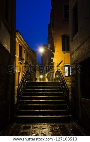 view through the narrow alleys of Venice at night
