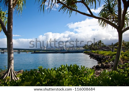 View through the trees / Pearl Harbor and submarine framed by two trees. Oahu, Hawaii