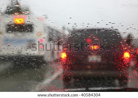 view through the windshield of a car during a rain storm