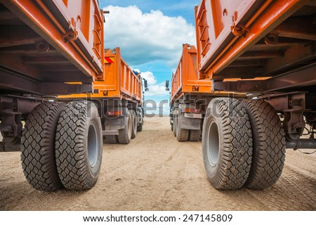 view through two rows of tippers close up #247145809