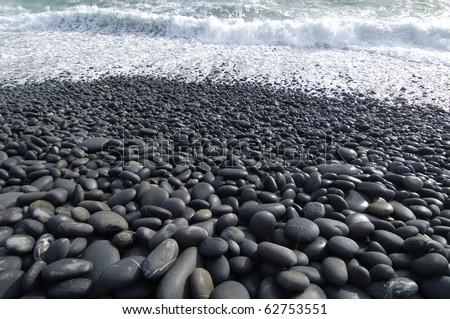 view through wet pebble on the sea