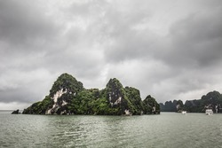 View throughout the islands of Ha Long Bay on a stormy summer's day in Ha Long Bay, Vietnam